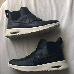 Nike navy water proof sneakers. High tops!